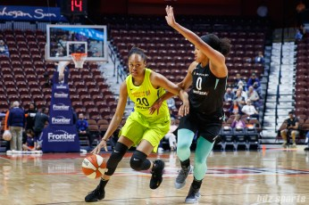 Dallas Wings Azura Stevens (30) and New York Liberty guard Marissa Coleman (0)