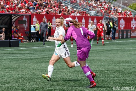 Team Canada goalie Stephanie Labbe (1) heads the ball out of danger