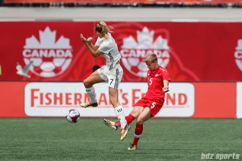 Team Canada defender Rebecca Quinn (5) and Team Germany forward Lea Schuller (7)