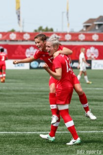 Team Canada midfielders Jessie Fleming (17) and Sophie Schmidt (13) celebrate Fleming's goal