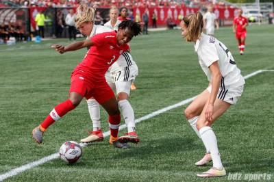 Team Canada defender Kadeisha Buchanan (3) and Team Germany defender Verena Faisst (17)