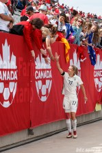 Team Germany defender Verena Faisst (17) high fives fans after a sold out Germany vs Canada match in Hamilton, Ontario.