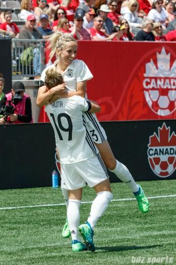 Team Germany forward Svenja Huth (19) celebrates her goal with teammate Kathrin Hendrich (3)