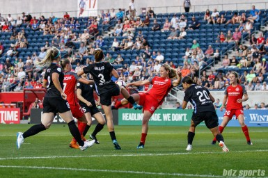 Portland Thorns midfielder Lindsey Horan (10) volleys a loose ball in the box