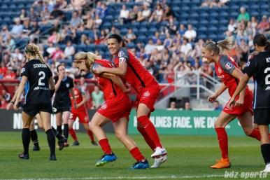 Portland Thorns players Lindsey Horan (10), Christine Sinclair (12), and Ana-Maria Crnogorcevic (7) celebrate Horan's equalizer goal
