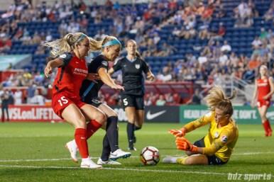 Chicago Red Stars midfielder Julie Ertz (8) shields Portland Thorns defender Ellie Carpenter (15) from the ball