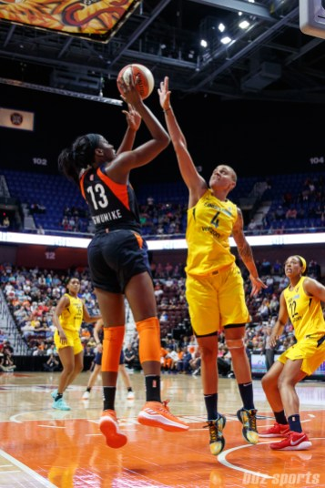 Connecticut Sun forward Chiney Ogwumike (13) and Indiana Fever forward Candice Dupree (4)