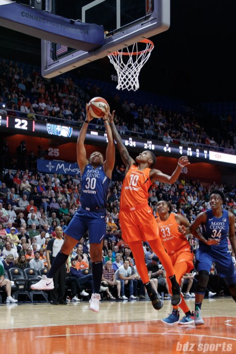 Minnesota Lynx guard Tanisha Wright (30) and Connecticut Sun guard Courtney Williams (10)