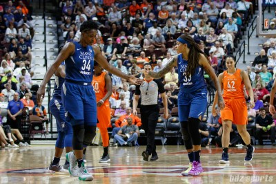 Minnesota Lynx center Sylvia Fowles (34) and forward Seimone Augustus (33)