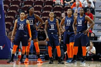 Connecticut Sun players Alex Bentley (20), Chiney Ogwumike (13), Courtney Williams (10), Morgan Tuck (33), and Shekinna Stricklen (40)