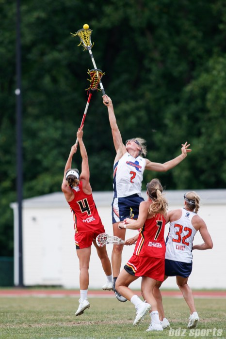 Baltimore Brave midfielder Marie McCool (4) and Upstate Pride attacker Danielle Spencer (2)