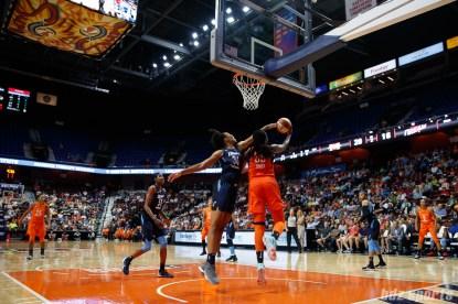 Connecticut Sun center Jonquel Jones (35) and Atlanta Dream center Imani McGee-Stafford (34)