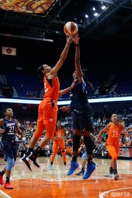 Connecticut Sun guard Jasmine Thomas (5) and Atlanta Dream center Elizabeth Williams (1)