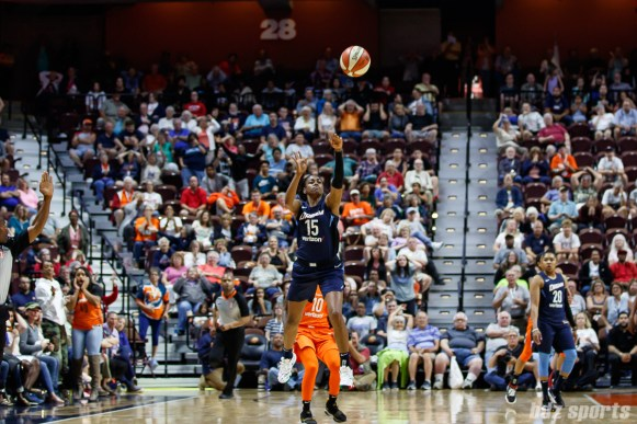 Atlanta Dream guard Tiffany Hayes (15) hits the game-winning shot from beyond half court