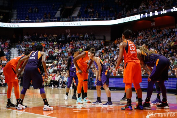 Connecticut Sun center Jonquel Jones (35) and Phoenix Mercury guard Leilani Mitchell (5)