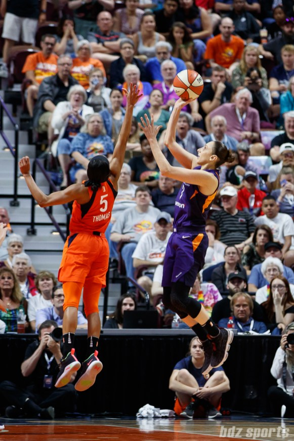 Connecticut Sun guard Jasmine Thomas (5) and Phoenix Mercury guard Diana Taurasi (3)