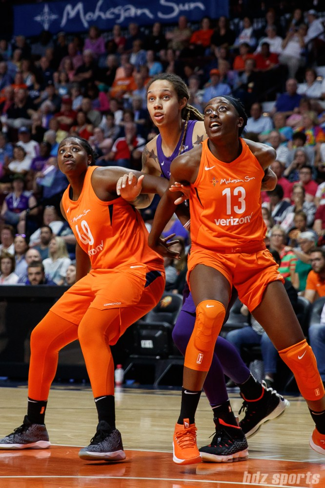 Connecticut Sun forwards Shekinna Stricklen (40) and Chiney Ogwumike (13) and Phoenix Mercury center Brittney Griner (42)