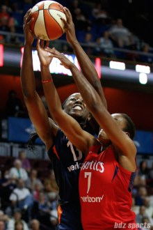 Connecticut Sun forward Chiney Ogwumike (13) and Washington Mystics guard Ariel Atkins (7)