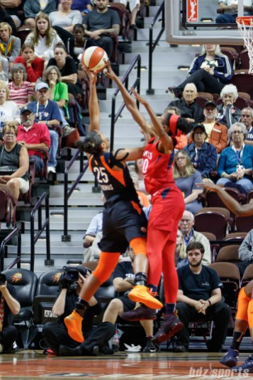 Connecticut Sun forward Alyssa Thomas (25) and Washington Mystics forward LaToya Sanders (30)