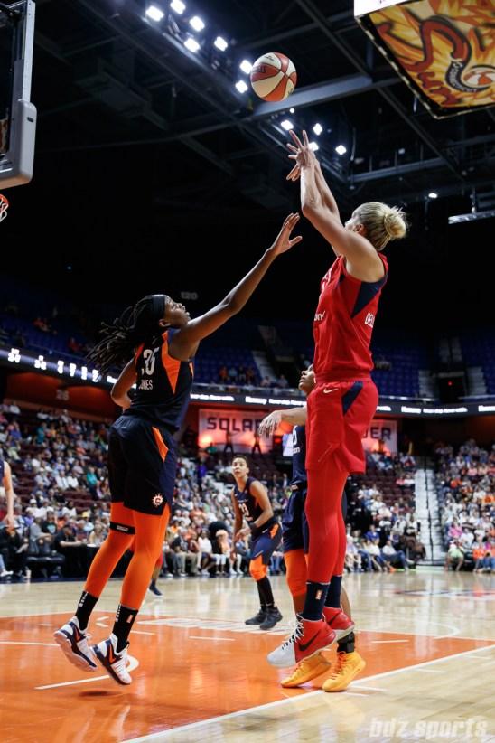 Connecticut Sun center Jonquel Jones (35) and Washington Mystics forward Elena Delle Donne (11)