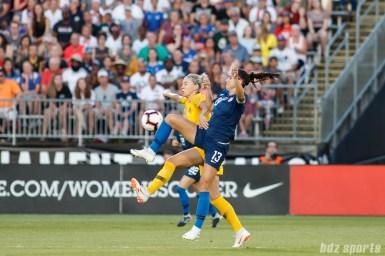 Team Australia defender Alanna Kennedy (14) and Team USA forward Alex Morgan (13)