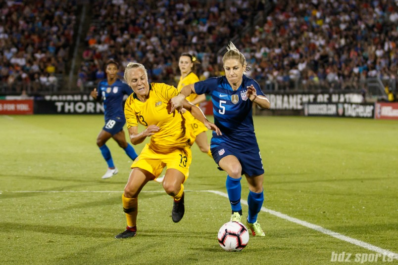 Team Australia midfielder Tameka Butt (13) and Team USA midfielder McCall Zerboni (5)
