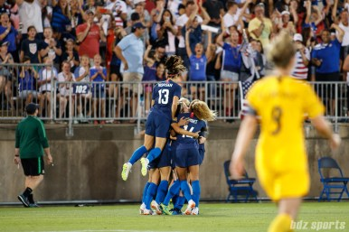 Team USA celebrates midfielder Lindsey Horan's game-tying goal in the 90th minute