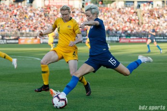 Team USA midfielder Megan Rapinoe (15) and Team Australia defender Clare Polkinghorne (4)