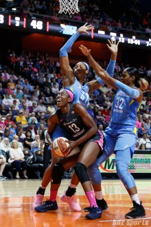 Connecticut Sun forward Chiney Ogwumike (13) and Chicago Sky players Alaina Coates (41) and Cheyenne Parker (32)