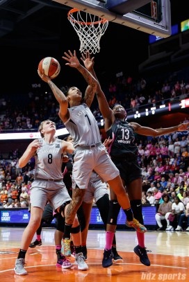 Las Vegas Aces forward Tamera Young (1) and Connecticut Sun forward Chiney Ogwumike (13)