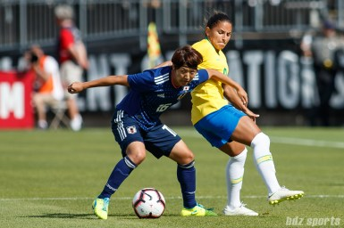 Team Japan midfielder Rin Sumida (16) and Team Brazil midfielder Debinha (9)