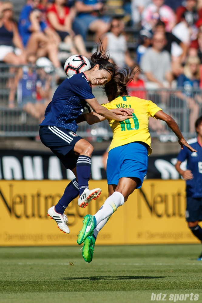 Team Japan defender Aya Sameshima (3) and Team Brazil forward Marta (10)