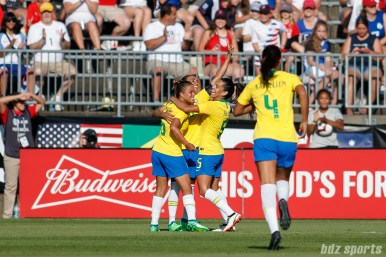 Team Brazil celebrates Marta's goal in the second half