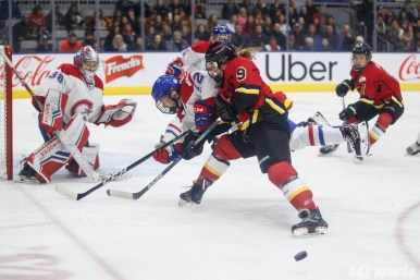 Montreal Les Canadiennes defender Catherine Daoust (12) and Calgary Inferno forward Dakota Woodworth (9)