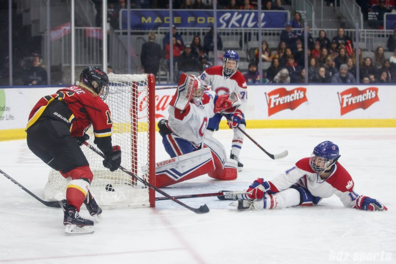 Montreal Les Canadiennes forward Jill Saulnier (11) slides to cover the net from Calgary Inferno forward Rebecca Leslie (16)
