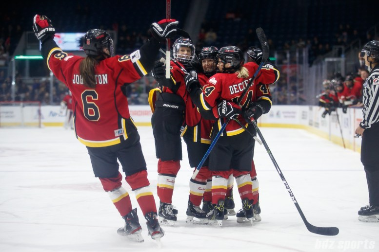 The Calgary Inferno celebrate Inferno forward Zoe Hickel's (44) first period goal