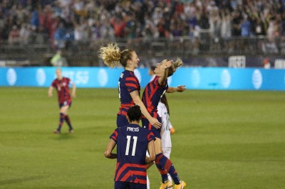 USWNT midfielder Samantha Mewis (3) chest bumps her sitser USWNT midfielder Kristie Mewis (6) in the first of two 2021 WNT Send-Off Series games between the USWNT and Mexico at Rentschler Field in East Hartford, CT on July 1, 2021.