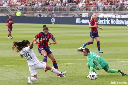 USWNT forward Christen Press (11) splits the Mexico defense in the second of two 2021 WNT Send-Off Series games between the USWNT and Mexico at Rentschler Field in East Hartford, CT on July 5, 2021.