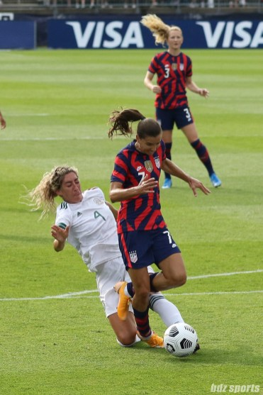 Team Mexico defender Jocelyn Orejl (4) tackles the ball away from USWNT midfielder Tobin Heath (7) in the second of two 2021 WNT Send-Off Series games between the USWNT and Mexico at Rentschler Field in East Hartford, CT on July 5, 2021.