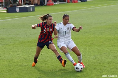 Team Mexico midfielder Maria Sanchez (11) battles USWNT defender Kelley O'Hara (5) for the ball in the second of two 2021 WNT Send-Off Series games between the USWNT and Mexico at Rentschler Field in East Hartford, CT on July 5, 2021.