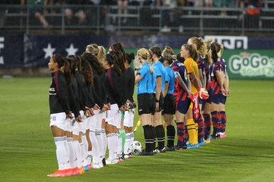 The USWNT and El Tri Femenil starting eleven during the national anthems in the first of two 2021 WNT Send-Off Series games between the USWNT and Mexico at Rentschler Field in East Hartford, CT on July 1, 2021.