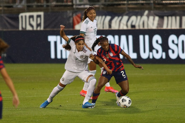 USWNT defender Crystal Dunn (2) attempts to keep the ball away from Team Mexico midfielder Daniela Espinosa (7) in the first of two 2021 WNT Send-Off Series games between the USWNT and Mexico at Rentschler Field in East Hartford, CT on July 1, 2021.