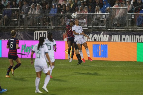 USWNT defender Crystal Dunn (2) and Team Mexico midfielder Maria Sanchez (11) battle in the air for the ball in the first of two 2021 WNT Send-Off Series games between the USWNT and Mexico at Rentschler Field in East Hartford, CT on July 1, 2021.