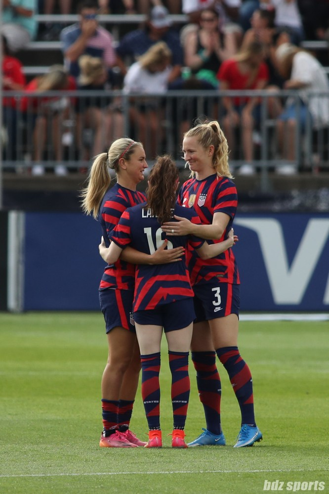 Team USA midfielders huddle before the start of the second of two 2021 WNT Send-Off Series games between the USWNT and Mexico at Rentschler Field in East Hartford, CT on July 5, 2021.