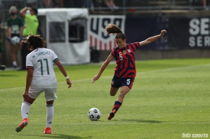 USWNT defender Kelley O'Hara (5) sends in the ball in the second of two 2021 WNT Send-Off Series games between the USWNT and Mexico at Rentschler Field in East Hartford, CT on July 5, 2021.