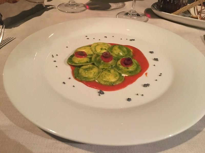 Locale Firenze Ravioli stuffed with Burrata cheese on a cream of cherry tomatoes and basil pesto