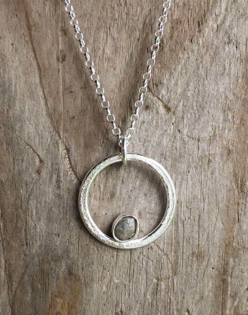 sand circle with diamond pendant