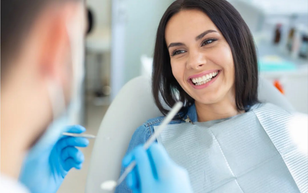 a woman smiling while being prepared for a possible tooth extraction