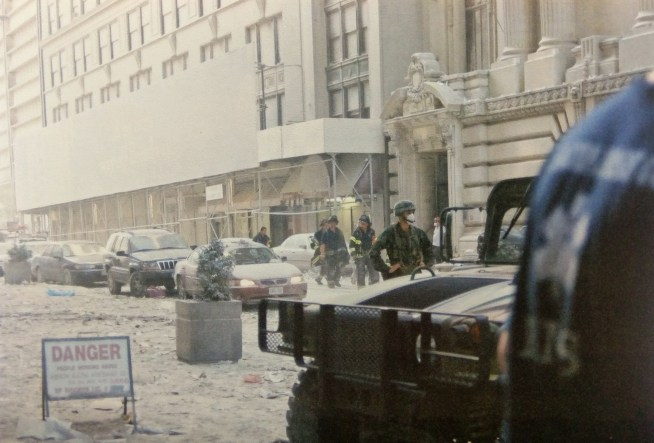 A look at the debris in Lower Manhattan and the soldier stationed outside the perimeter on Sept. 12, 2001. (Jeremy Rodorigo photo)