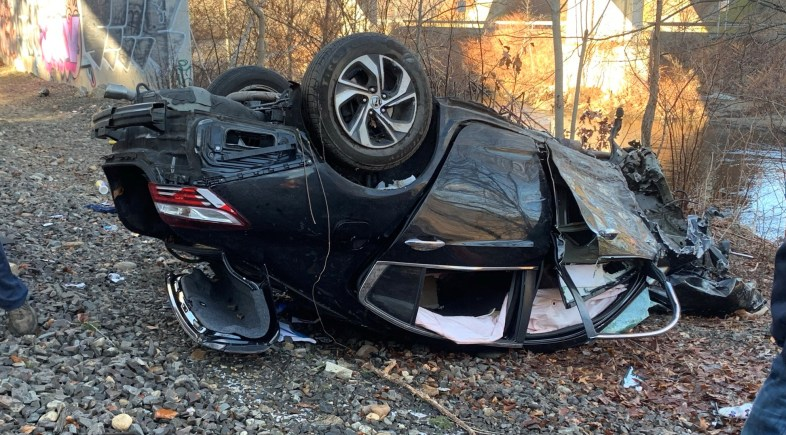 Car Crashes Off Route 8 North Bridge, Onto Train Tracks